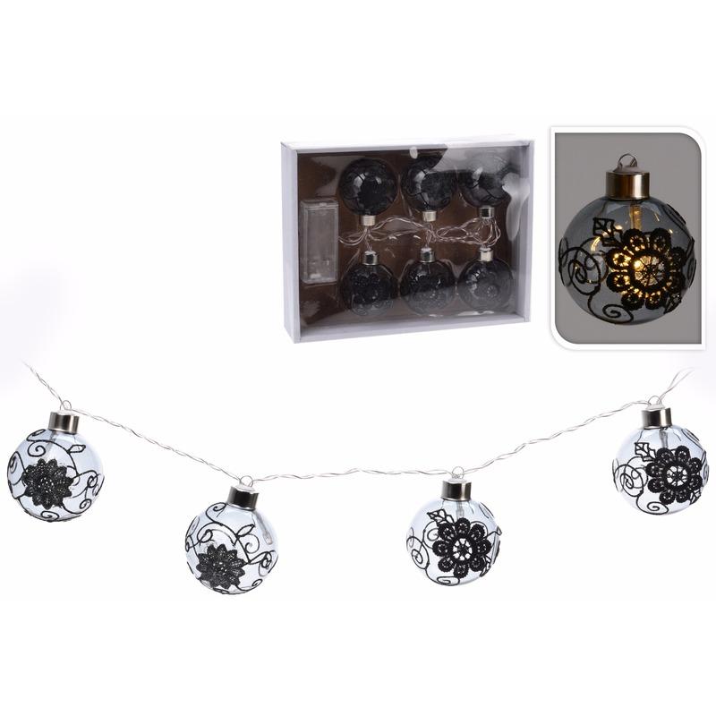 Kerstboomslinger met lichtgevende zwarte kerstballen op LED